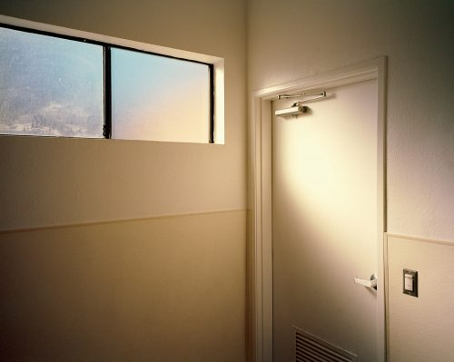 Palm Springs, California, bathroom, light, warm, orange, window, door, 6x7, film, color, kodak